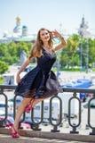 Young beautiful woman in fashion black dress Royalty Free Stock Photo
