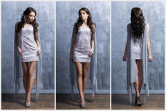 Young and beautiful woman in a fashion dress Royalty Free Stock Photography