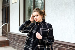 Young beautiful woman with a fashionable bag Royalty Free Stock Photo