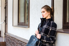 Young beautiful woman with a fashionable bag Stock Image