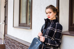 Young beautiful woman with a fashionable bag Stock Photos