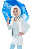 The young beautiful woman in the fashionable dress. Under a blue umbrella on a white background Royalty Free Stock Images