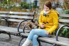 Young beautiful woman feeding a squirrel in Madison Square Park Royalty Free Stock Photos