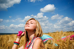 Young beautiful woman in field Stock Images