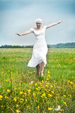 Young beautiful woman on field Royalty Free Stock Images