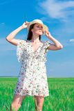 Young beautiful woman on field Royalty Free Stock Image