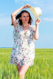 Young beautiful woman on field Royalty Free Stock Photo
