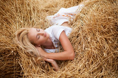 Young beautiful woman on field Royalty Free Stock Photos