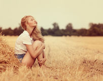 Young beautiful woman on field Stock Photo