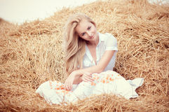 Young beautiful woman on field Stock Photography
