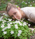 The young beautiful woman in the field of blossoming snowdrops in the early spring Royalty Free Stock Image