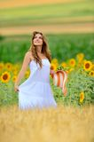 Young beautiful woman on field in summer Royalty Free Stock Photography