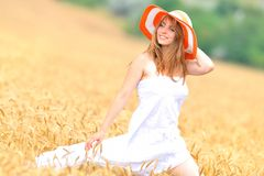 Young beautiful woman on field in summer Royalty Free Stock Images