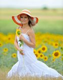 Young beautiful woman on field in summer Stock Photo