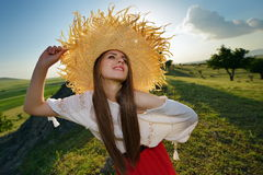 Young beautiful woman on field in summer Royalty Free Stock Image