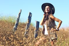 Young Beautiful Woman on a Field in Summer Time Royalty Free Stock Image