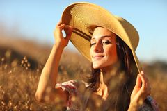 Young Beautiful Woman on a Field in Summer Time Stock Images
