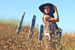Young Beautiful Woman on a Field in Summer Time Royalty Free Stock Photography