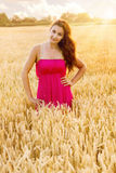 Young beautiful woman in field of wheat Stock Photo