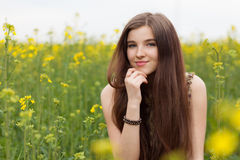 Young beautiful woman in the fields Royalty Free Stock Photos