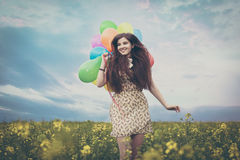 Young beautiful woman in the fields Royalty Free Stock Images
