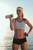 Young beautiful woman during fitness Royalty Free Stock Photos