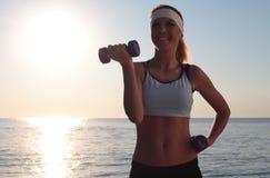 Young beautiful woman during fitness Stock Photos