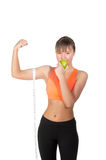 Young beautiful woman after fitness time and exercising with green apple Stock Images
