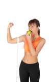 Young beautiful woman after fitness time and exercising with green apple Stock Photo