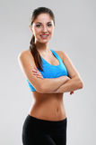 Young beautiful woman in fitness wear Stock Photography
