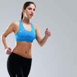 Young beautiful woman in fitness wear Royalty Free Stock Image