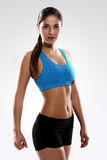 Young beautiful woman in fitness wear Stock Images