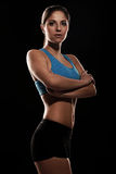 Young beautiful woman in fitness wear Royalty Free Stock Photos