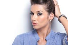 Young beautiful woman fixing her hair Stock Image