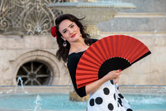 Young beautiful woman in a flamenco costume. Stock Photo