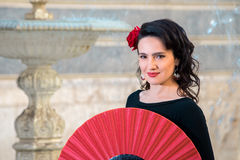 Young beautiful woman in a flamenco costume. Royalty Free Stock Image