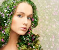 Young beautiful woman with floral pattern Stock Images