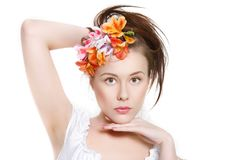 Young beautiful woman in floral wreath Stock Images