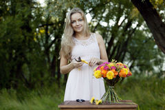 Young beautiful woman florist. The girl in the Royalty Free Stock Photography