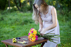 Young beautiful woman florist. The girl in the Stock Image