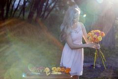 Young beautiful woman florist. The girl in the Stock Photography