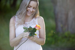 Young beautiful woman florist. The girl in the Royalty Free Stock Photo