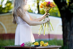 Young beautiful woman florist. The girl in the Royalty Free Stock Images