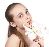 Young beautiful woman with a flower. On a white background royalty free stock photo