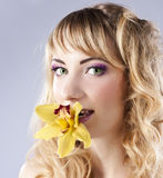 Young beautiful woman with flower Stock Photos