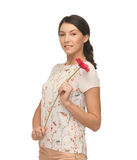 Young and beautiful woman with flower Royalty Free Stock Photos