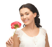 Young and beautiful woman with flower Royalty Free Stock Image