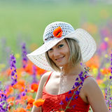 Young beautiful woman on flower field in summer Stock Images