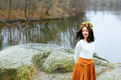 Young beautiful woman with flower wreath outdoors near the river Stock Images