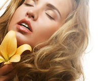 Young beautiful woman with flower Stock Photo